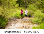 active beautiful young couple... | Shutterstock . vector #691977877