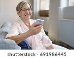 portrait of smiling senior... | Shutterstock . vector #691986445