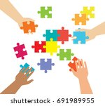hands and pieces of puzzles on... | Shutterstock .eps vector #691989955