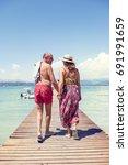 modern mature couple relaxing... | Shutterstock . vector #691991659