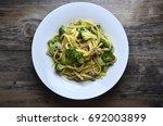 broccoli spaghetti in white... | Shutterstock . vector #692003899
