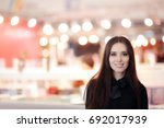 smiling elegant woman wearing ... | Shutterstock . vector #692017939