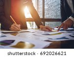 hand of a business man holding... | Shutterstock . vector #692026621