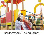 playful child with parents at... | Shutterstock . vector #692035024