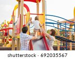 young mother and father playing ... | Shutterstock . vector #692035567