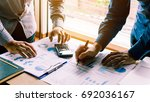 two businessman team calculate...   Shutterstock . vector #692036167