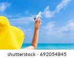 model airplane in female hand...   Shutterstock . vector #692054845