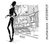 fashion girl on a street... | Shutterstock .eps vector #692058919