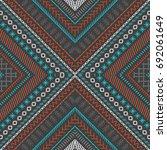 seamless dark ethnic texture.... | Shutterstock . vector #692061649