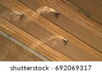 aerial view on three combine...   Shutterstock . vector #692069317
