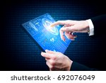 businessman using tablet with... | Shutterstock . vector #692076049