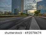 empty asphalt road through... | Shutterstock . vector #692078674