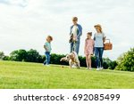 happy young family with picnic... | Shutterstock . vector #692085499