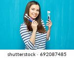 smiling young woman with dental ... | Shutterstock . vector #692087485