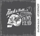 skull  guitar  rock n roll in... | Shutterstock .eps vector #692089609