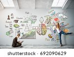 man with laptop and cheerful... | Shutterstock . vector #692090629