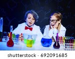 shocked kids in the chemical... | Shutterstock . vector #692091685