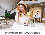 romantic girl with blonde curls ... | Shutterstock . vector #692095801