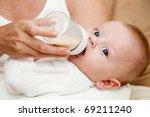 Mother Feeding Newborn Son With ...