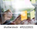 asian business woman write on... | Shutterstock . vector #692122021