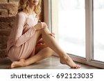 beautiful long slender female... | Shutterstock . vector #692123035