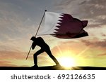 qatar flag being pushed into... | Shutterstock . vector #692126635