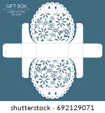 openwork gift box with a lace... | Shutterstock .eps vector #692129071