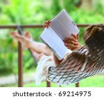 young woman reading a book...   Shutterstock . vector #69214975