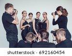 photographers paparazzi take... | Shutterstock . vector #692160454