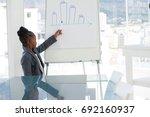 confident businesswoman giving... | Shutterstock . vector #692160937