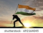 india flag being pushed into... | Shutterstock . vector #692164045
