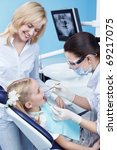 Child treated teeth in the dental clinic - stock photo