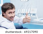Attractive man in a the dental chair - stock photo