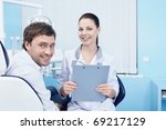 Doctor and patient in the dental clinic - stock photo
