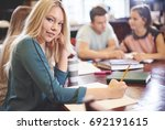 female student working towards... | Shutterstock . vector #692191615