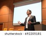 speaker giving talk on podium... | Shutterstock . vector #692205181