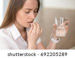 unhealthy woman with pained... | Shutterstock . vector #692205289