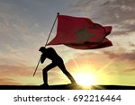 morocco flag being pushed into... | Shutterstock . vector #692216464
