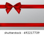 red gift bow and ribbon.   Shutterstock .eps vector #692217739