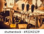 beer tap with fresh brewed... | Shutterstock . vector #692242129