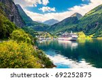 sunny summer scene of geiranger ... | Shutterstock . vector #692252875