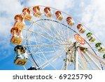 ferris wheel against a blue sky   Shutterstock . vector #69225790