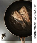 Small photo of Frying fish in pan is the easy way to make a wonderful and favorable dish.It is a mount watering meal.