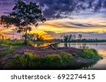 nice view of sunset over lake ... | Shutterstock . vector #692274415