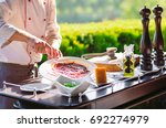 show kitchen. the cook prepares ... | Shutterstock . vector #692274979