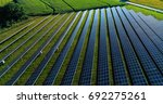 solar panels in aerial view | Shutterstock . vector #692275261