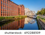 gray metal bridge over canal... | Shutterstock . vector #692288509