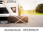 changing wheel on a car | Shutterstock . vector #692304619