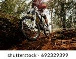rider of bike downhill mountain ... | Shutterstock . vector #692329399