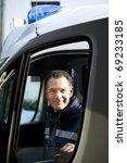 Male Paramedic Driving Ambulance